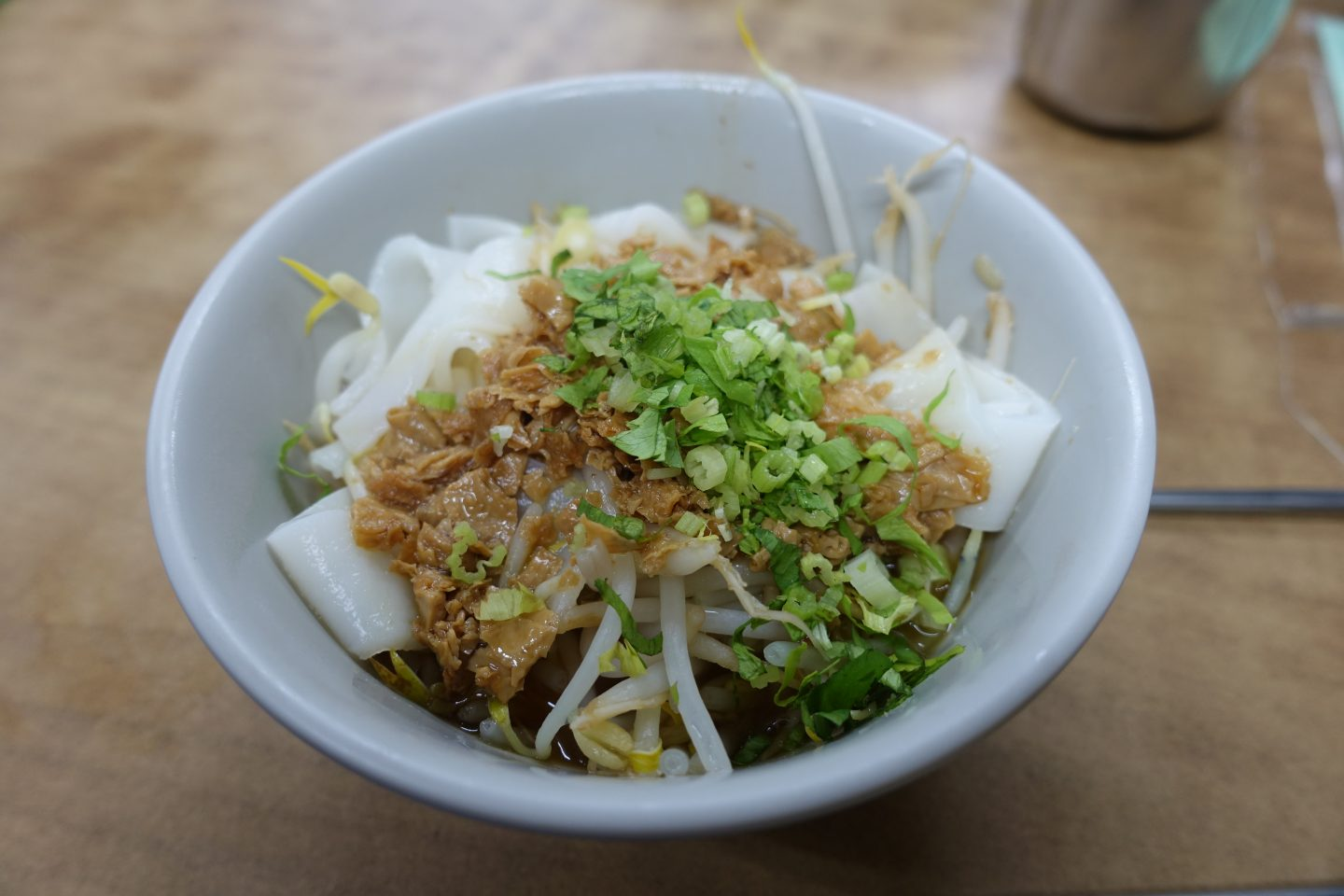 The best place to eat vegan food in Taipei Xiu Yuan Su Shi - TThick rice noodles with vegetarian mock meat sauce